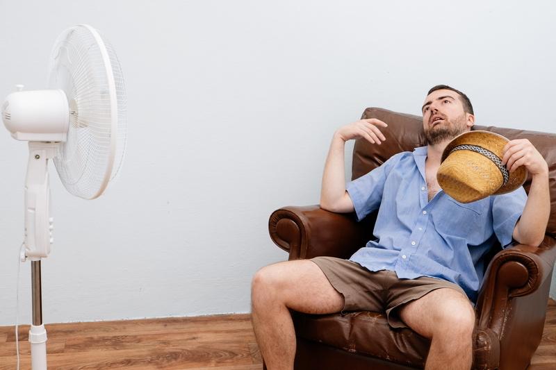 overheated-man-using-fan