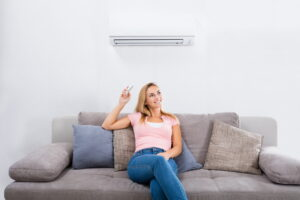 woman-using-heat-pump